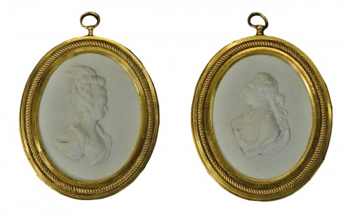 A pair of hard paste biscuit Louis XVI and Marie Antoinette portraits