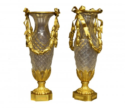 A fine pair of Louis XVI ormolu mounted cut-glass vases