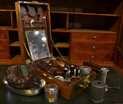 A mahogany officer`s travelling dressing and breakfast set -