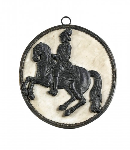 17th century sign, Cast iron horseman in a marble medallion