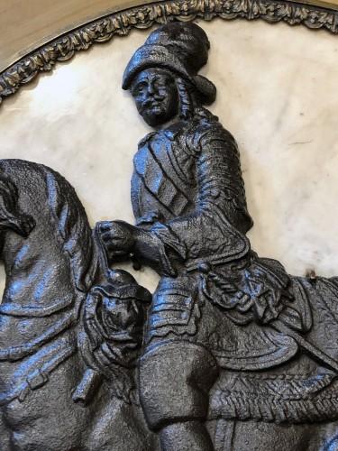 Curiosities  - 17th century sign, Cast iron horseman in a marble medallion