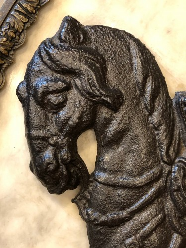 17th century sign, Cast iron horseman in a marble medallion -