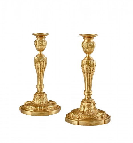 A fine pair of Louis XVI ormolu candlesticks