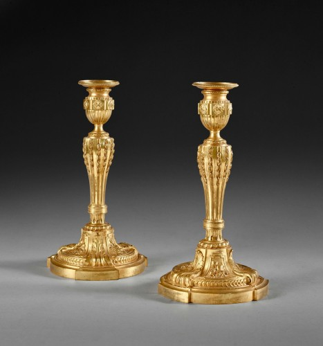 A fine pair of Louis XVI ormolu candlesticks -