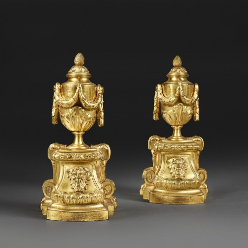 Pair of andirons with vase -