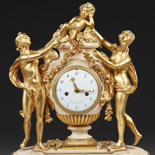 Pendulum in the shape of a vase surrounded by two Graces and a love - Horology Style Louis XVI