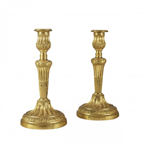 A Pair of candle holder with roughened flutes embellished with oak leaves f