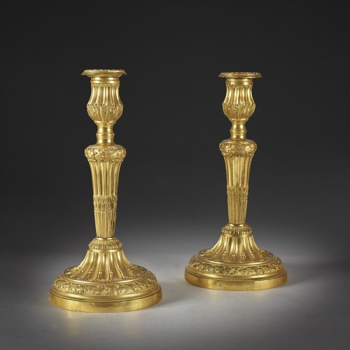 A Pair of candle holder with roughened flutes and oak leaves frieze -