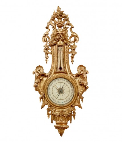 Barometer-thermometer of carved and gilt wood