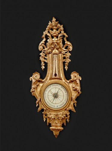Barometer-thermometer of carved and gilt wood -