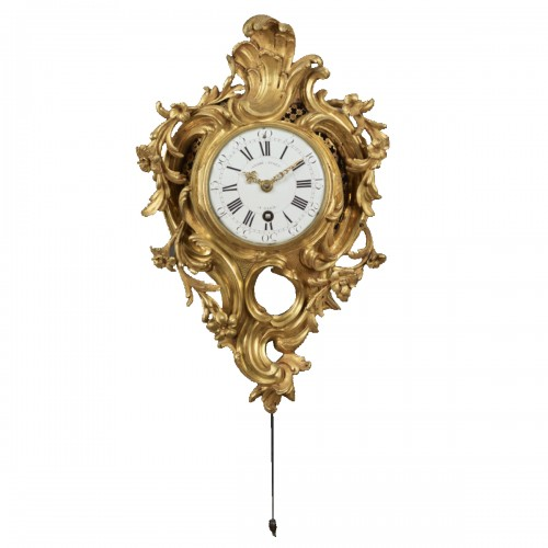 An alcove cartel clock in chased and gilt bronze