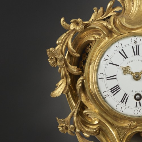 Horology  - An alcove cartel clock in chased and gilt bronze