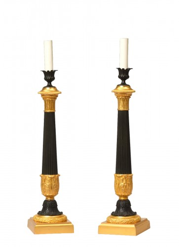 Pair of bronze oil lamps