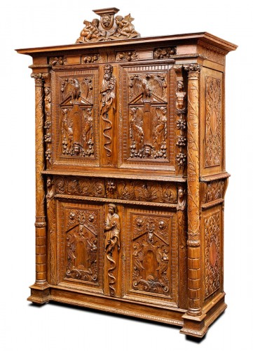 A Rare Renaissance walnut cabinet with its freestanding carved columns