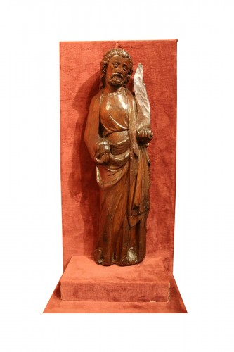 A carved wooden figure of a Saint holding a phylactery