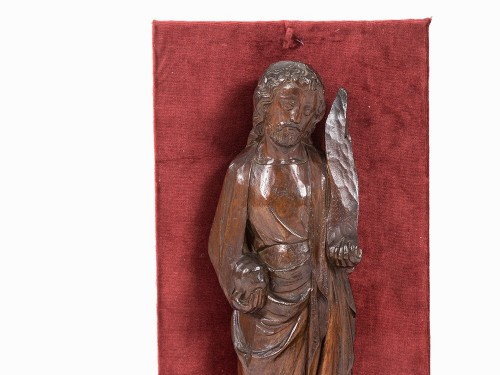 A carved wooden figure of a Saint holding a phylactery -
