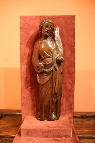 Middle age - A carved wooden figure of a Saint holding a phylactery