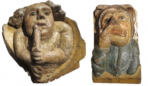 A pair of corbels with audacious subjects from the Middle Ages