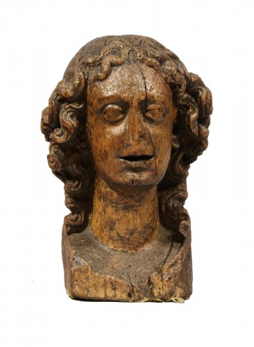 Wood carved depiction of the head of an angel