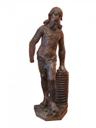 Wood sculpture representing a wild man