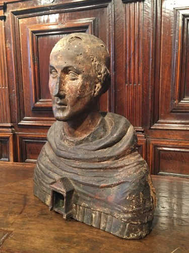 Polychrome reliquary bust of a monk -