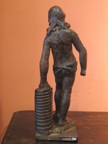 Wood sculpture representing a wild man -