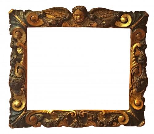 Rare partly gilt carved wood frame
