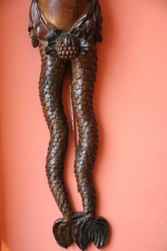 - Carved wood bracket depicting a mermaid