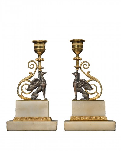 A pair of patinated and gilded bronze candleholders - George II style