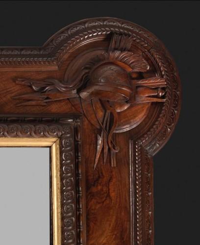 Pietro Giusti (1822-1878) - Walnut frame carved with military attributes -