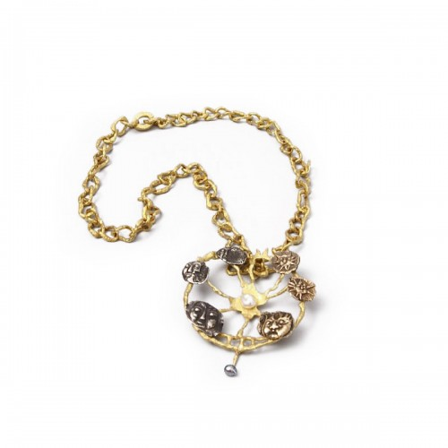 """""""Roue"""" gold necklace designed by Jean Lurçat for Patek Philippe"""