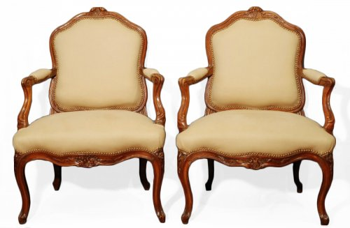 A pair of  Louis XV  carved walnut armchairs