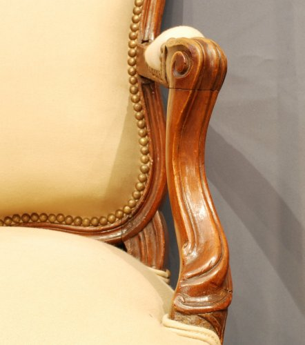 Seating  - A pair of  Louis XV  carved walnut armchairs