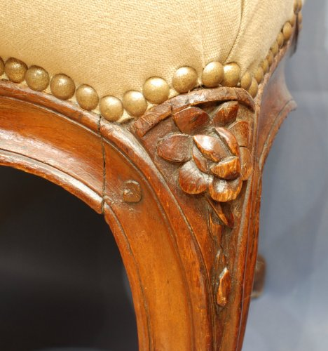 A pair of  Louis XV  carved walnut armchairs -