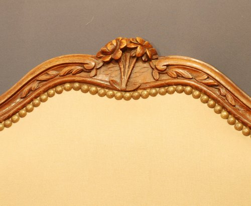 Louis XV - A pair of  Louis XV  carved walnut armchairs