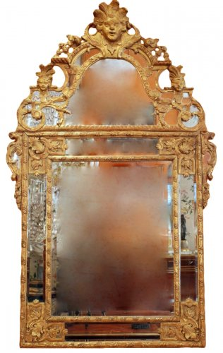 A Régence carved and giltwood mirror