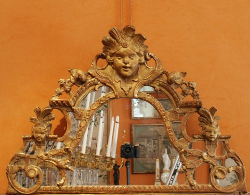 A Régence carved and giltwood mirror -