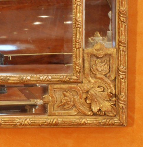 A Régence carved and giltwood mirror - French Regence