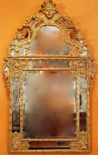 Antiquités - A Régence carved and giltwood mirror