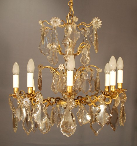 A Louis XV period crystal chandelier .