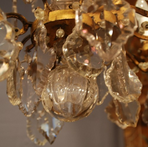 Lighting  - A Louis XV period crystal chandelier .