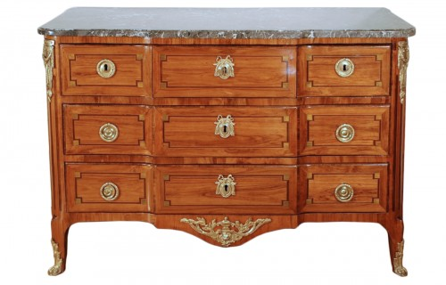 A french Transition tulipwood and ormolu commode