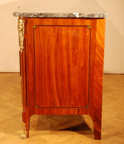 A french Transition tulipwood and ormolu commode -