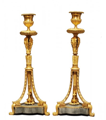 A pair of Louis XVI ormolu candlesticks