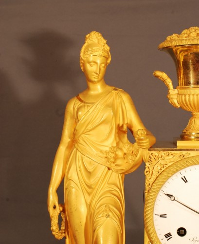 Clocks  - Flora. A french ormolu Empire period clock