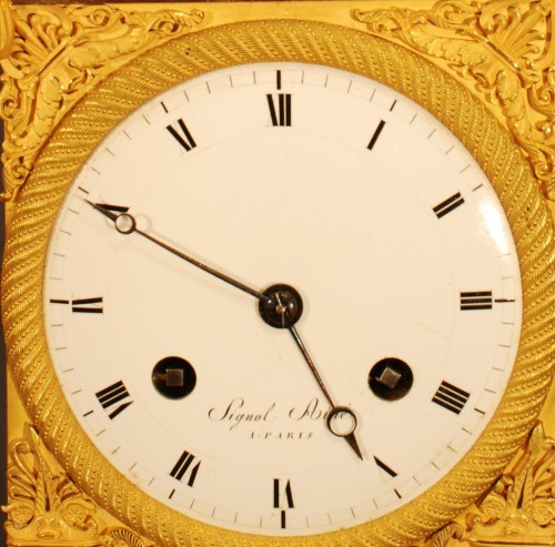 Antiquités - Flora. A french ormolu Empire period clock