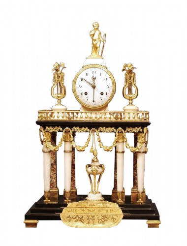 A Louis XVI clock signed Robert à la Chaux-de-Fonds