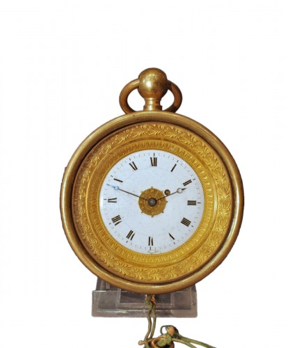 An Empire ormolu coach clock