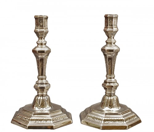A French Régence pair of silver bronze candlesticks