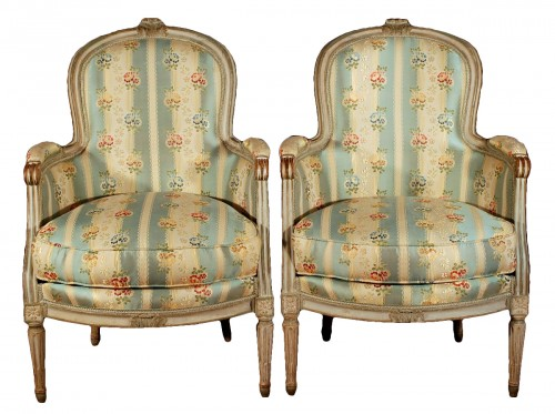 A french Louis XVI pair of wing chairs